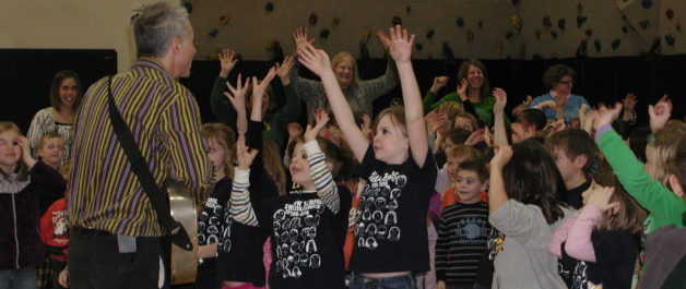 kids enjoying performance of Stuart Stotts - engaged, hands in the air like they just don't care